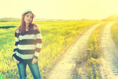 Girl in hat fashion field sunset Royalty Free Stock Photos