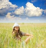 Girl  in hat at  field Royalty Free Stock Photo