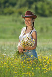 Girl in hat in field Royalty Free Stock Images