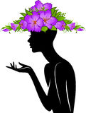 Girl in hat from flowers. Beautiful silhouette of girl in hat from flowers on white background Royalty Free Stock Photos