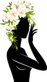 Girl in hat from flowers. Beautiful silhouette of girl in hat from flowers on white background Royalty Free Stock Photography