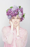 The girl with the hat of flowers. Spring, summer. The girl with the hat of flowers, pink tone Stock Photos