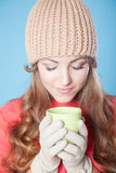 The girl in the hat froze and drinking hot tea Stock Image