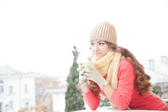 The girl in the hat froze and drinking hot tea. 1 stock photography