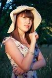 Girl in a hat in the garden stock photos