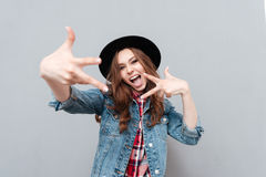Girl in hat gesturing with hands and looking at camera. Close up portrait of a excited happy girl in hat gesturing with hands and looking at camera isolated over Stock Photography