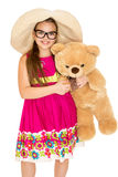 The girl in the hat and glasses with Teddy bear Royalty Free Stock Images