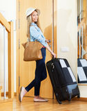 Girl in hat going on vacation with  suitcase Royalty Free Stock Images