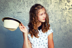 The girl with a hat. Greeting, openness, happiness.Retro toning. Royalty Free Stock Images