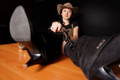Girl in a hat with a gun Royalty Free Stock Image