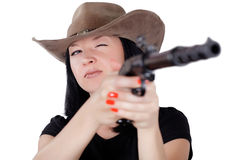 Girl in a hat with a gun aiming Royalty Free Stock Photography