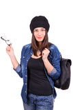 Girl in a hat holding a backpack Royalty Free Stock Images