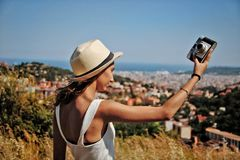 Girl with hat holding a camera. stock images
