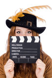 Girl in hat holding clapperboard isolated on white Royalty Free Stock Image