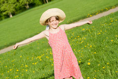 The girl in a hat holding a flower Royalty Free Stock Photos