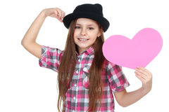 Girl in a hat holding a paper heart Stock Photography