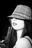 Girl in hat holding pistol Stock Image