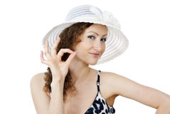 Girl in the hat indicates the sign of ok Stock Image
