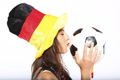Girl With Hat Kissing The Ball Stock Photo