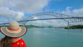 Girl with hat looking at steel bridge of the Americas in the Panama Canal. Girl with hat looking at metal bridge of the Americas in the Panama Canal stock footage