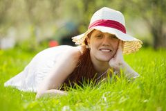 Girl in hat lying on meadow Royalty Free Stock Photo