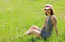 Girl in hat lying at meadow Royalty Free Stock Photo