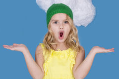 Girl in a hat makes a gesture of surprise Stock Image