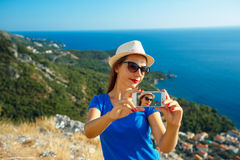 Girl in the hat making selfie by the smartphone  Royalty Free Stock Images