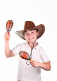 Girl in a hat with maracas Stock Photos