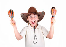 Girl in a hat with maracas Royalty Free Stock Photography