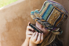Girl Hat Mouth Organ Royalty Free Stock Image