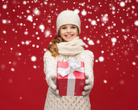 Girl in hat, muffler and gloves with gift box Royalty Free Stock Photography