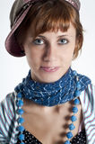 Girl with hat and necklace blue Stock Image