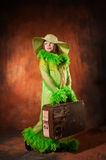 Girl in a hat with an old suitcase Royalty Free Stock Images