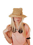 Girl with hat over face. royalty free stock image