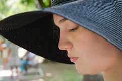 Girl with hat. In park on summer day Royalty Free Stock Photos