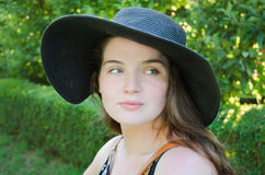 Girl with hat in park. On summer day Stock Photos