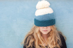 Girl with hat pulled over her eyes. Teenager with hat pulled over her eyes. Space for text Royalty Free Stock Photos