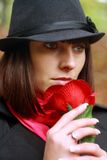 Girl in hat with red rose Royalty Free Stock Photos