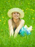 Girl in hat relaxing in grass Royalty Free Stock Images