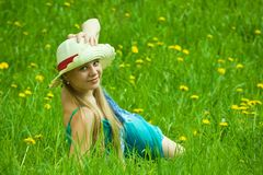 Girl in hat relaxing in grass Stock Photography