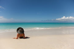 Girl with hat relaxing in tropical beach Royalty Free Stock Images