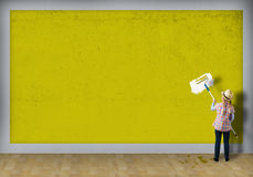 Girl with hat roller wall paints Stock Photography