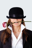 The girl in a hat with a rose in her teeth Royalty Free Stock Images