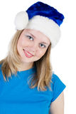 Girl in the hat of Santa Claus Stock Photos