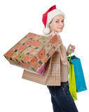 Girl in the hat of Santa Claus Royalty Free Stock Images