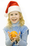 Girl in the hat of Santa Claus Royalty Free Stock Image