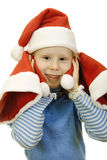 Girl in the hat of Santa Claus Stock Photo