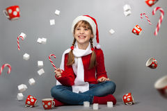Girl in the hat of Santa Claus with a cup Stock Image