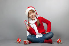 Girl in the hat of Santa Claus with a cup Stock Photo